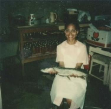 Myrtle Owens with Fish and Canned Goods